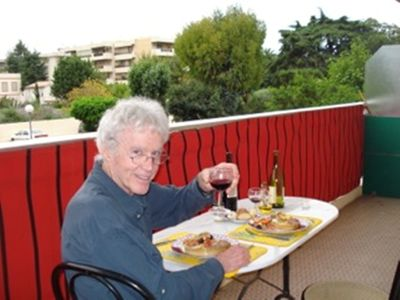 Guest enjoying wine and dinner on the balcony