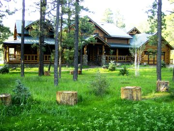 Greer cabin rental - View of the front of the cabin. Includes 2 car garage.