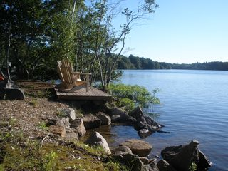 Dennis Village cottage photo - Deck on lakefront with Adirondack Chairs and 1 of 3 swimming entrances.
