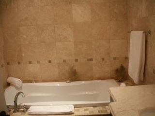 Providenciales - Provo condo photo - Master bedroom ensuite with bath tub and rain shower