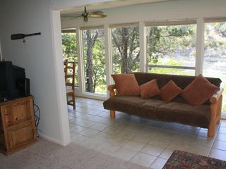 Leander cottage photo - Sunroom with queen futon