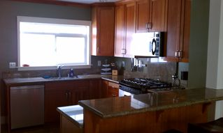 Seattle house photo - Cooks kitchen with granite countertops, breakfast bar and gas range