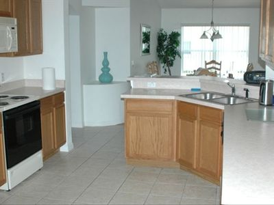 Modern, bright, fully-equipped kitchen.