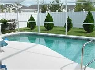 Private Screened Pool Area with Patio furniture & Sun lounger's provided
