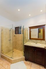 Tamarindo condo photo - Guest bathroom with walk in shower