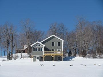View of the house from the lower part of the field. It is winter wonderland.