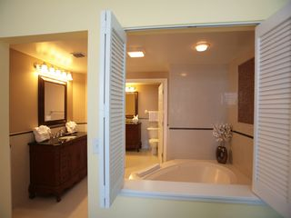 Elegant master on suite bathroom spa with jacuzzi and 2 vanities. - Daytona Beach condo vacation rental photo