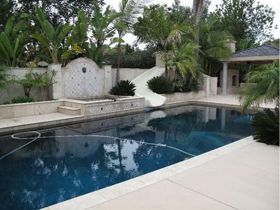 View of the Pool, Waterslide, Large Jacuzzi (Plus Waterfall and Water Features)!