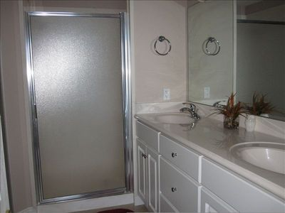 Master bathroom with dual vanity and dual head walk in shower
