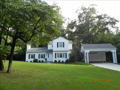 The house is situated on a large wooded lot in a quiet neighborhood close to AU.