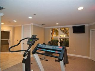 Cocoa Beach condo photo - Workout room with tv, view of river, restroom, sauna & steam room.
