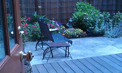 Private deck and beautifully landscaped all level garden
