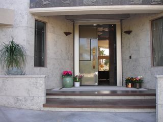 Indian Wells estate photo - Front entry - limestone and bronze