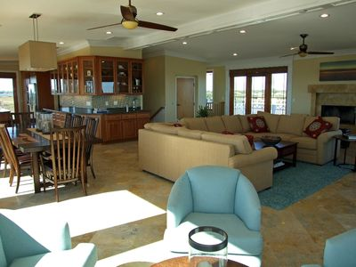 3rd fl- seating everywhere; TV; game table; fireplace; dining area; huge kitchen