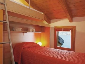 Le Vele Terrazzo ~ The second bedroom furnished with contemporary bunk beds
