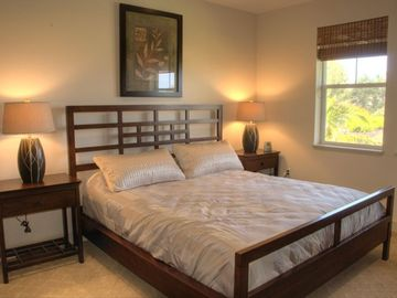 Master Bedroom with king bed and a view of the ocean right from your pillow