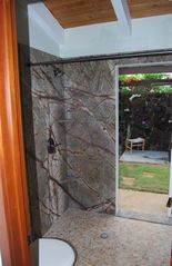 Poipu house photo - Rainforest suites private indoor and outdoor shower options.
