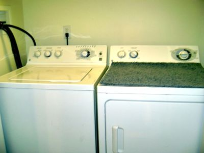 full size washer and dryer located off of main hallway