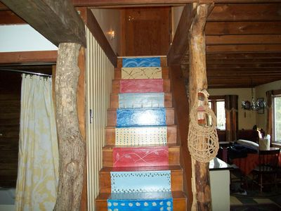 Damariscotta cabin rental - Stairway to the bedrooms & half bath on 2nd floor .