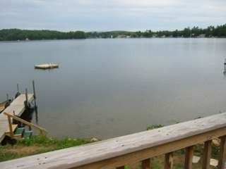 Lake Winnisquam cabin photo - View from deck showing dock and swim raft.