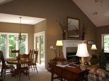Lake Ouachita condo rental - Great room with wood burning fireplace and dining area