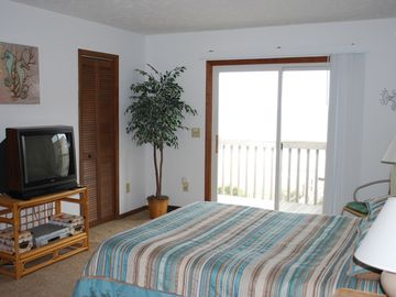 Watch Sunrise from bed! Spacious Master bedroom with private deck, full bath.