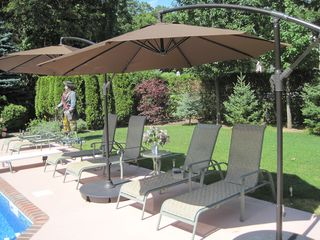 Hampton Bays house photo - Chaise lounges with shade umbrellas