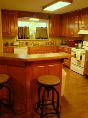 Carters chateau / country house photo - Country kitchen with counter seats for four.