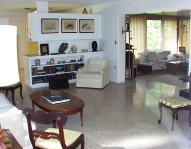 Sparkling terrazzo floors, large living room with adjoining airy Florida Room