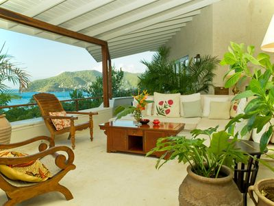 Bequia house rental - The 70ft terrace at Cassava, Bequia. The open gazebo dining area is at near end.