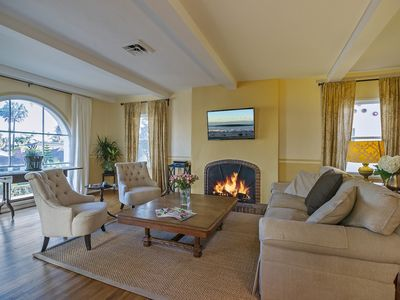 Santa Barbara apartment rental - View sunshine and palm trees from the comfort of the living room.