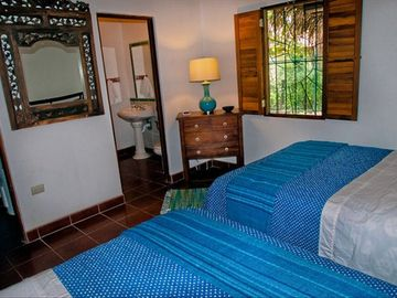 Bedroom #3 has a private bathroom, two queen size beds & A/C.