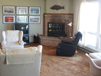 Comfortable living area w/ panoramic lake view.