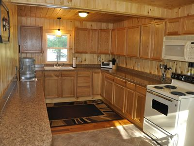 Brand New Kitchen with All the Amenities and View of the Lake.