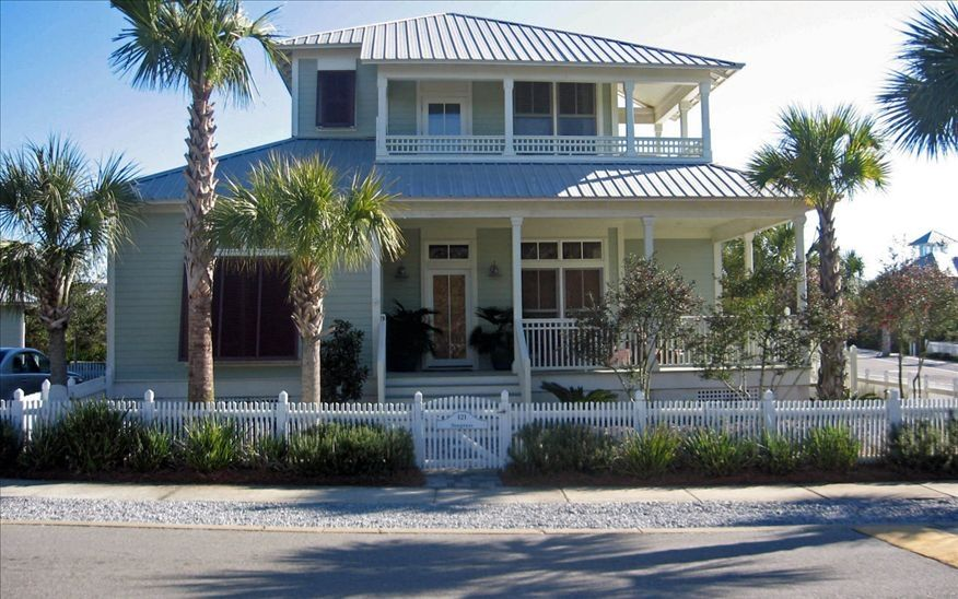 Poolside home in carillon beach vrbo for Beach house with wrap around porch