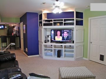 Media area with 55 inch flat panel and surround sound, second fireplace.