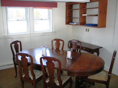 The Sow's Ear, a Franconia Notch Vacations Property - The Dining Room rest just on the otherside of the kitchen and between it and the living area, just as one would expect of a traditional North Country accommodation.