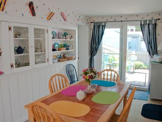 Mashpee cottage photo - Bright, sunny dining room leading to deck
