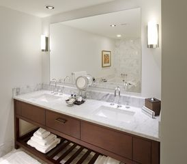Honolulu condo photo - The suite's baths are elegant and well-appointed.