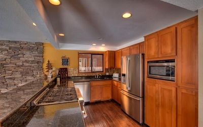 Kitchen with Granite Counter-Top and High-End Appliances