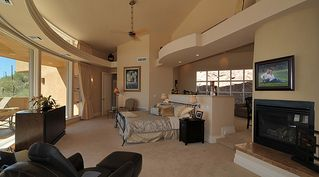 Tucson house photo - Master suite with fireplace, bath, sitting area behind bed and private patio