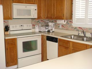 Surfside Beach condo photo - Luxury equipped kitchen with large counter/breakfast bar