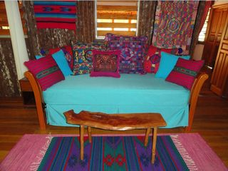 Mountain Pine Ridge villa photo - Couch/ trundle bed on jungle deck (can be set up as king sized bed)
