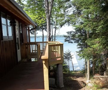 Cabin entrance and deck - view to pier and lake.