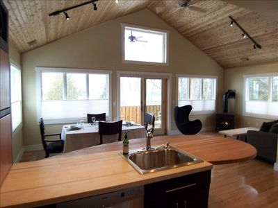 Upper level kitchen to living/dining area with deck overlooking the Lake.