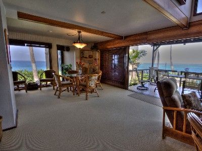 The wide-open feel of the tropical livingroom, dining room, and lanai is yours