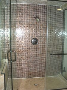 Master Bathroom: Shower with imported European Tile and travertine.