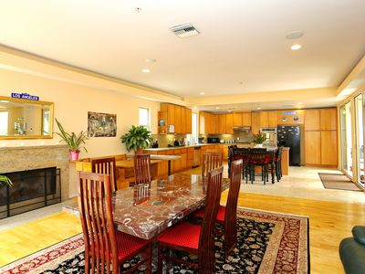 Dining Room into Kitchen. Fireplace & Plenty of seating for family dinners