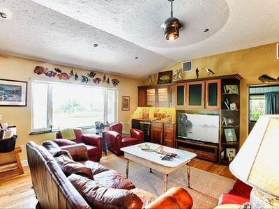 "spacious den with 52"" TV, wet bar and great views of Hooker Bay and sunsets."