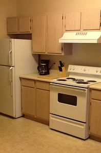 Full kitchen, with refrigerator, stove, microwave & dishwasher.